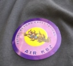 Stickers given at check-in. used to sort people at gates i think